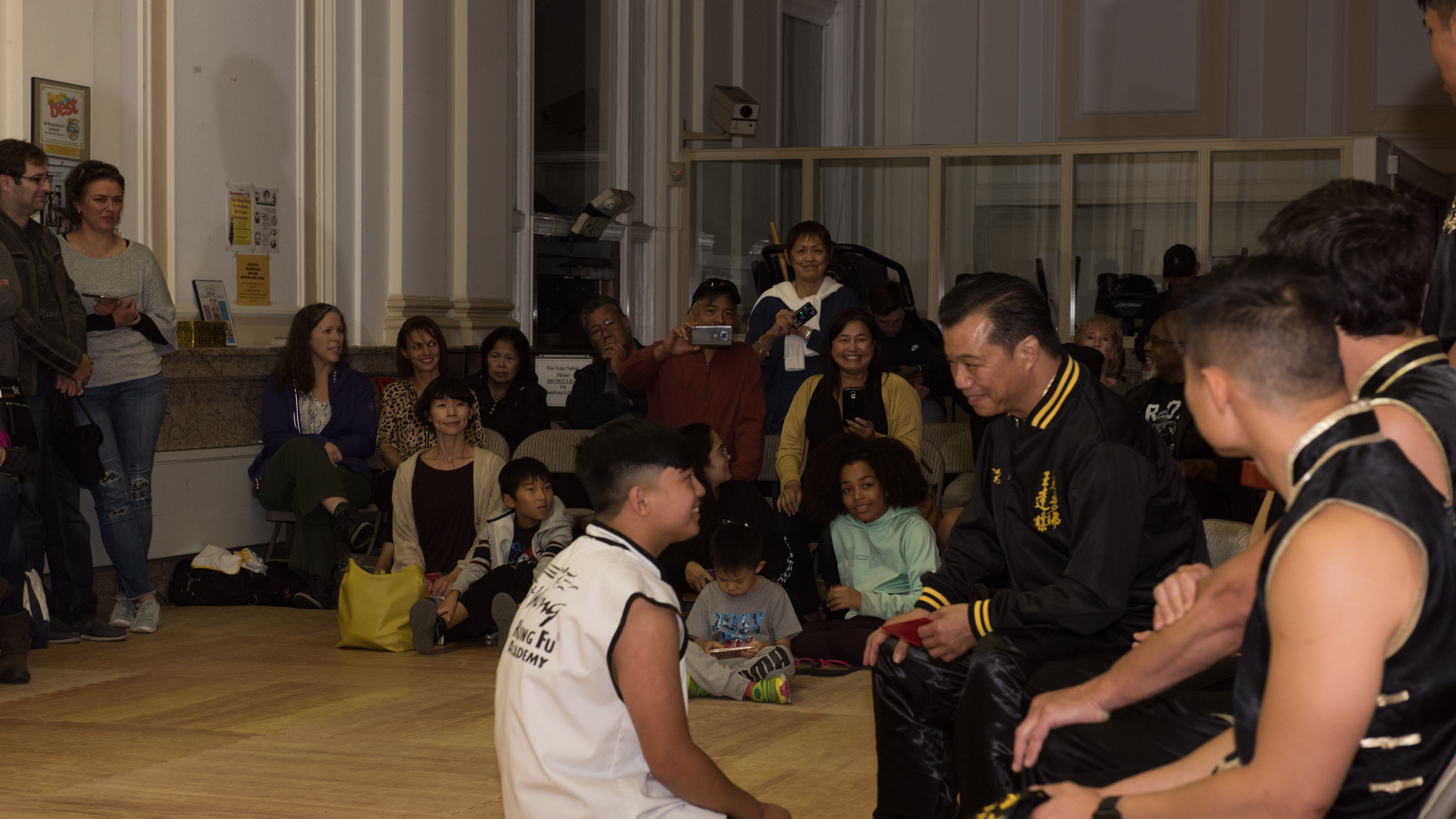 Upon receiving their black belt, each graduate receives a few words of encouragement from Grand Master Tat Wong.