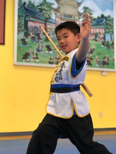 Perform the SIL LUM GUM (Shaolin Staff)