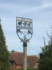 Close up of the Aldington village sign_
