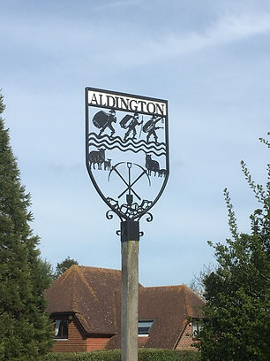 Close up of the Aldington village sign_