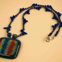 Fused glass central pendant with blue glass beads and silver findings