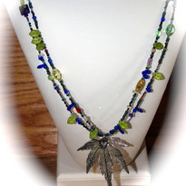 Mixed glass bead necklace with dipped leaf