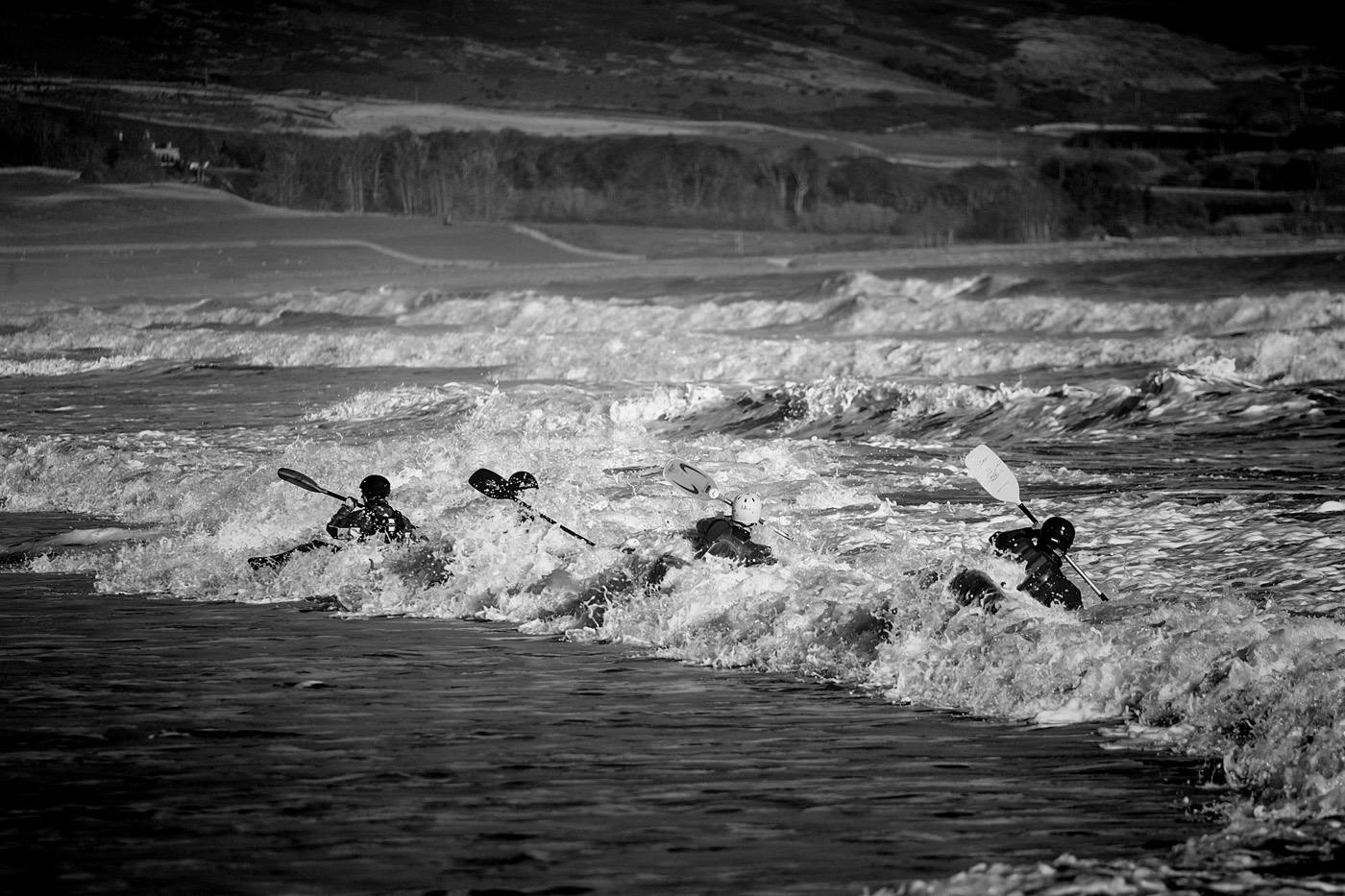 Surfing off of Brora beach with big wave