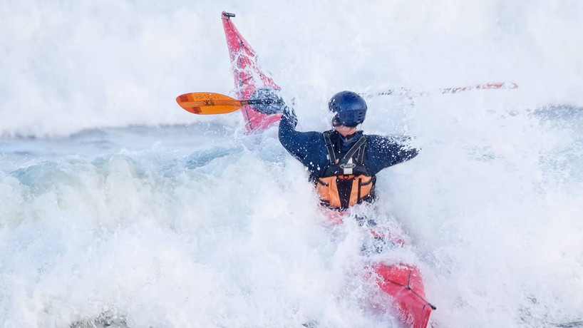 Gerald Urquhart surfing on Sea.jpg
