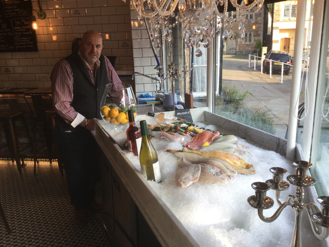 Don and wet fish counter.JPG