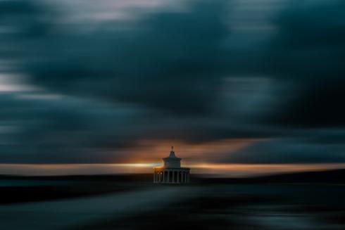 Lighthouse Against Cloudy Motion Sky