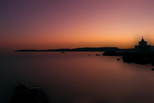 Lighthouse Against The Sunset