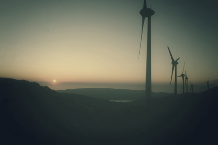 Wind Mills Against The Sunset