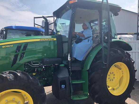 Sr. Luvia on Tractor.jpg