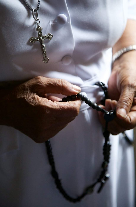 Sr. Luvia holding rosary.jpg
