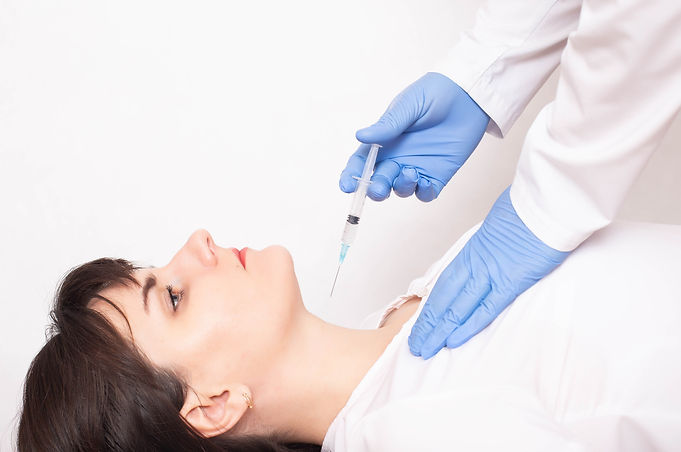doctor does a biopsy on a thyroid gland
