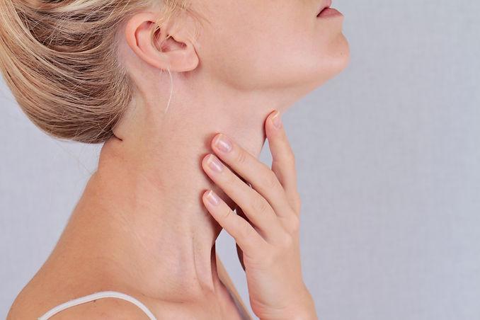 Woman thyroid gland control.jpg