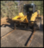 Skidsteer with mat grapple