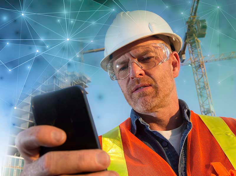 A worker in the field accessing GPS enabled training from the PinPoint app on his mobile device.