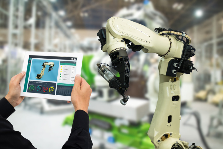 A worker operating a robot with their mobile device.
