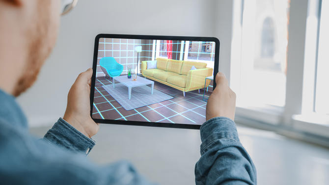 A user using augmented reality to envision new furniture in their apartment.