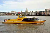 DHL Express riverboat on river with St P