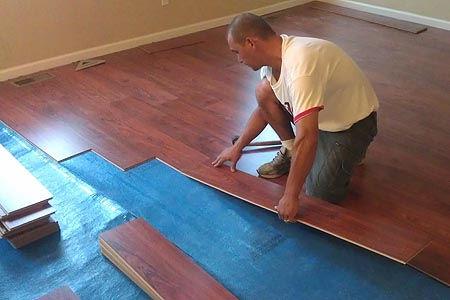 man putting in flooring