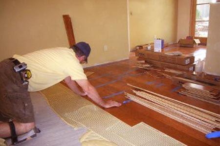 man putting flooring in