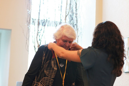Mary Ehrlich accepts a medal from Amelia Vader, Executive Director, at the 2019 Dedication ceremony for faith community nurses and graduation for the Health Ministries Network Foundations in Faith Community Nursing Course.