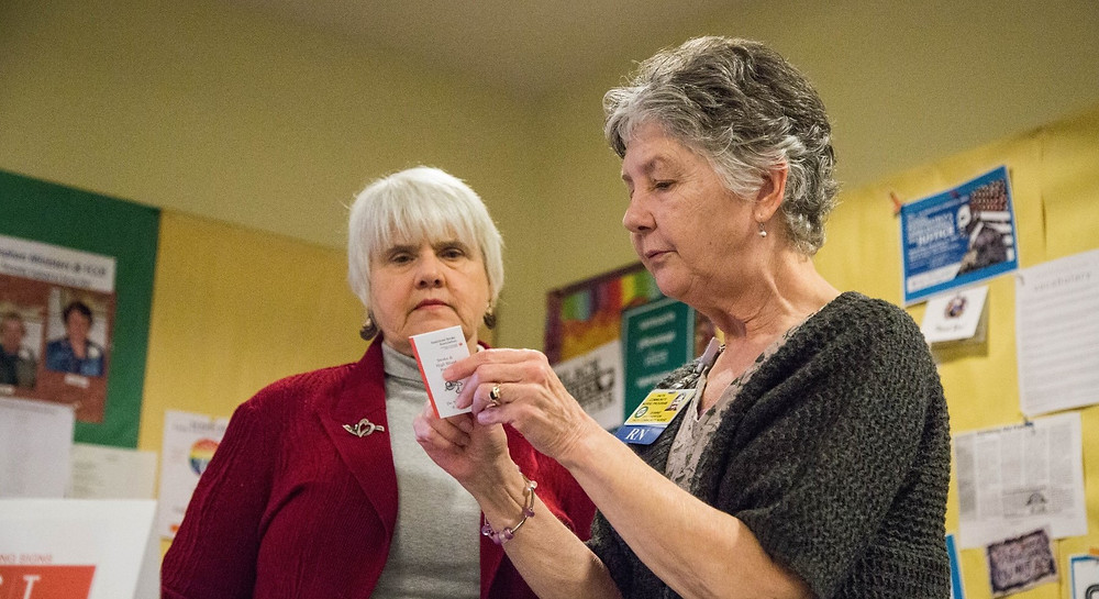 Jeanne Brotherton, FCN,  assists a congregant at First Congregational United Church of Christ, Bellingham.