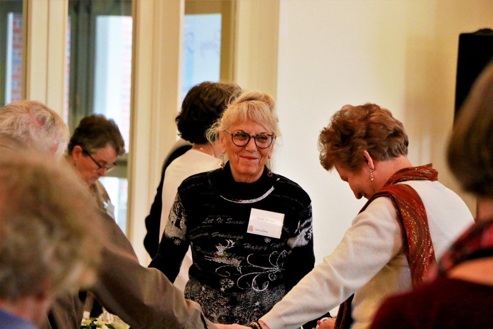 Dotty smiles at Carol hold hands.jpg