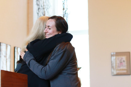 Alanna Steele Hugs Annette Stixrud at the 2019 Dedication ceremony for faith community nurses and graduation for the Health Ministries Network Foundations in Faith Community Nursing Course.