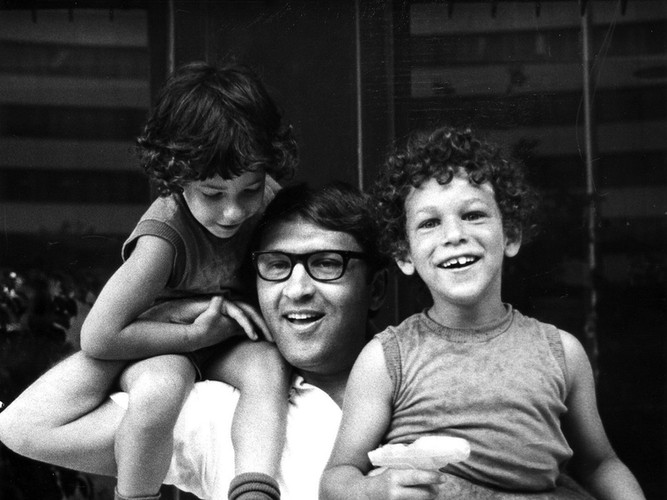 Sandy with sons Jimmy on his shoulder and Paul in his arm.