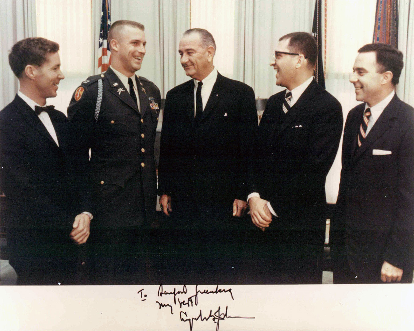 "Lyndon Johnson was thrilled to learn that four of the ""Ten Outstanding Young Men in America"" for 1967 were working for him. From left, they are Les Brown, William Carpenter, Sandy, and future HEW Secretary Joseph Califano. Carpenter was the famous ""lonesome end"" of the West Point football team."