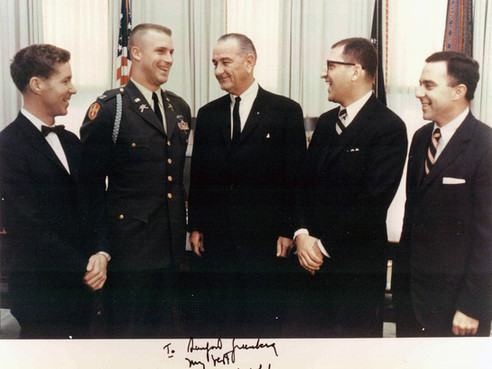 """Lyndon Johnson was thrilled to learn that four of the """"Ten Outstanding Young Men in America"""" for 1967 were working for him. From left, they are Les Brown, William Carpenter, Sandy, and future HEW Secretary Joseph Califano. Carpenter was the famous """"lonesome end"""" of the West Point football team."""