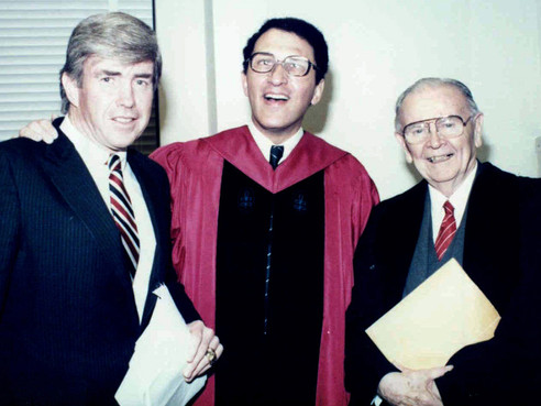 """Sandy with congressman and former Buffalo Bills quarterback Jack Kemp, at left, and Justice William Brennan, during Sandy's 1986 induction as a fellow of Brandeis University. Justice Brennan was one of Sandy's """"wise elders,"""" while Kemp's advice to """"throw deep"""" has played a key role in his life."""
