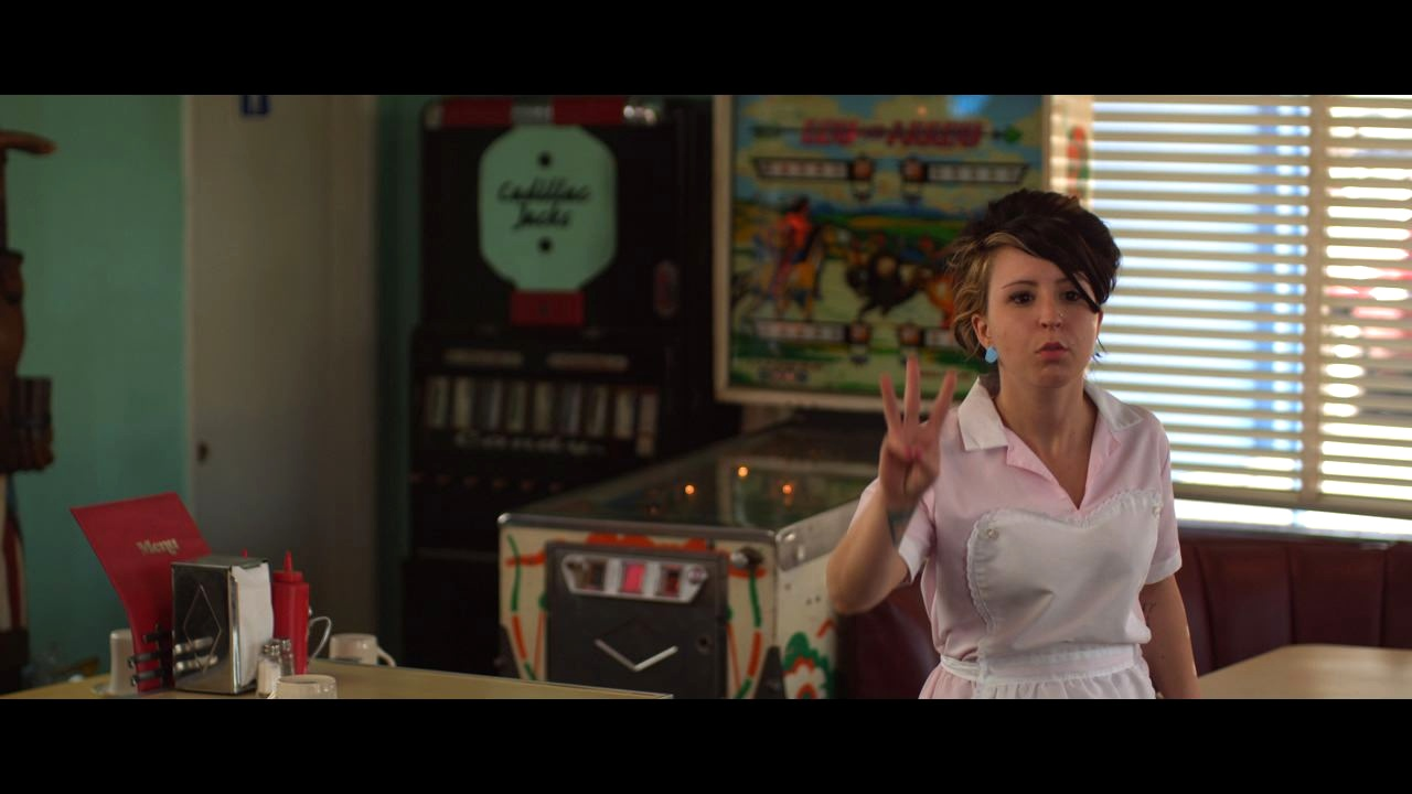 Sirah as the cafe waitress!