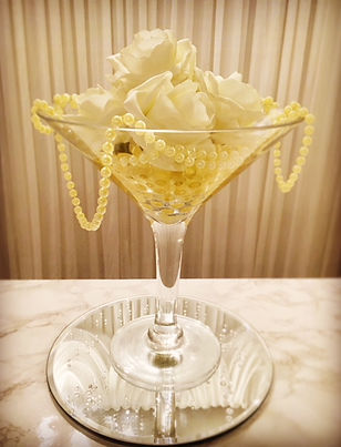 Cocktail vase centre piece decorated with gold water beads, ivory foam roses & pearl drapes