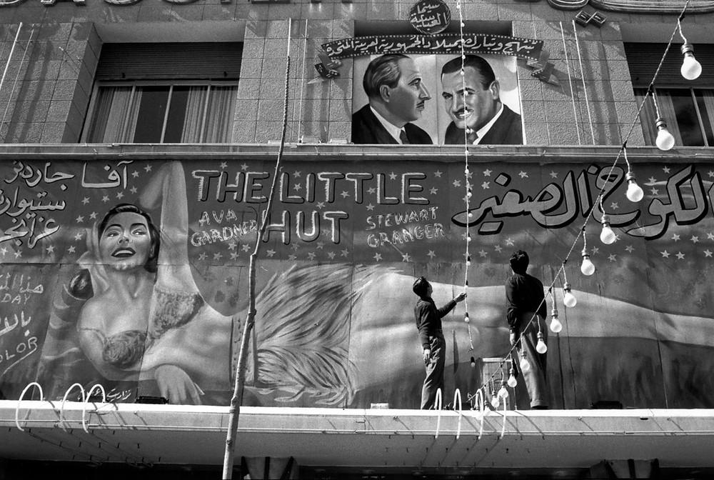 Rene Burri. Damascus. Poster of the Egyptian President Gamal Abdel NASSER over a film poster. 1958
