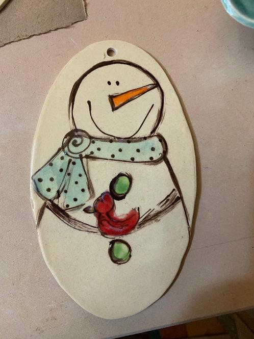 Snowman with bird orn