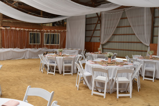 Wedding Reception Round Tables in a Barn