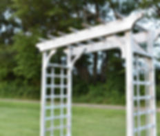 Rustic white wedding ceremony arbor