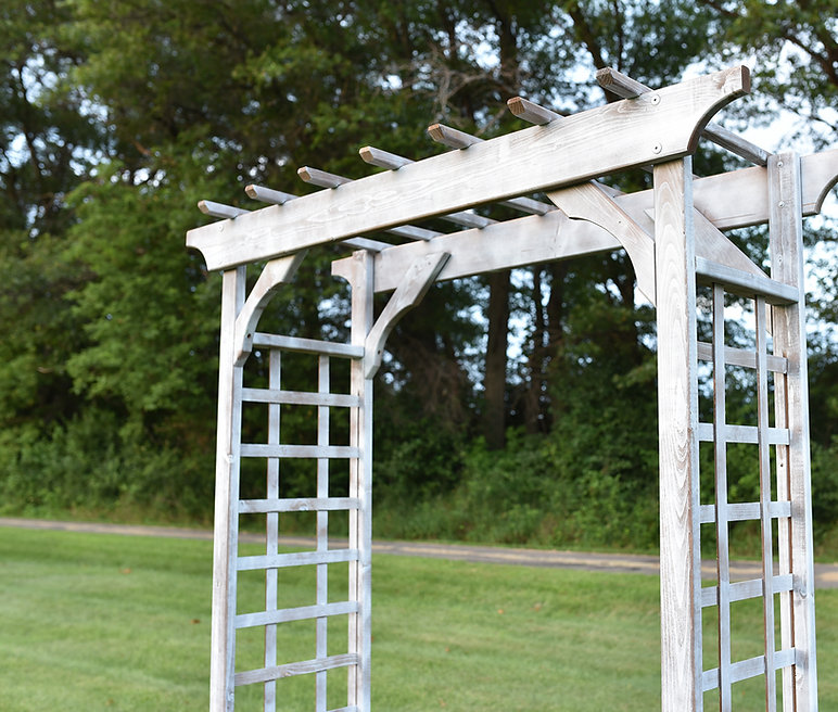 Rustic white wedding ceremony arbor