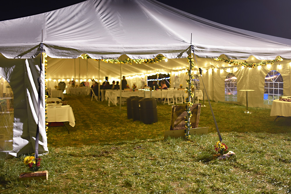 Large Wedding tent on a family property at night