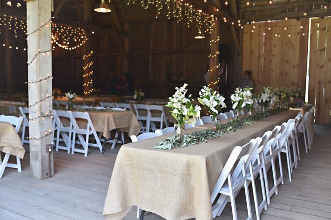 Wedding Reception Tables in a Barn