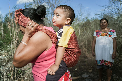 The Natives - Maya Yucateca | Paulina carrying her grandson Jonatan.