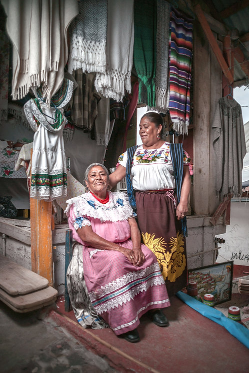The Natives - Purépecha | Mother and daughter in a market.