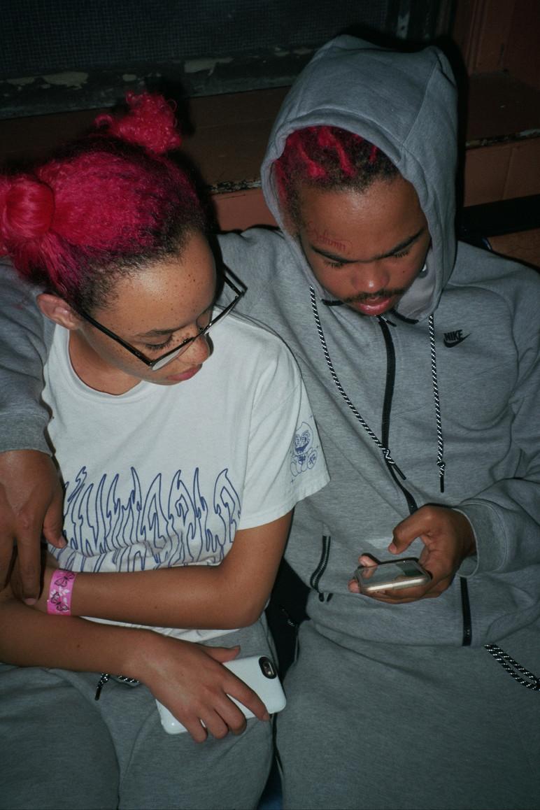 Adamn And Killavesi Look At Phone