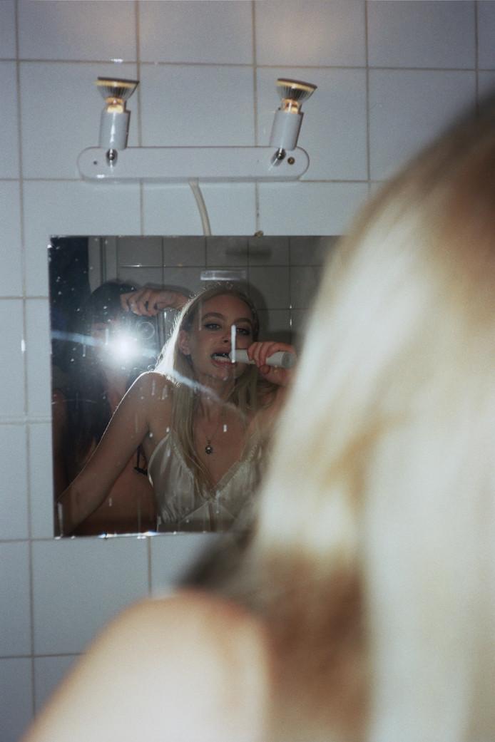 Dana brushing her teeth