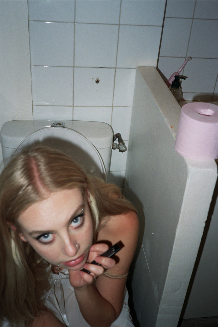 Dana on the toilet