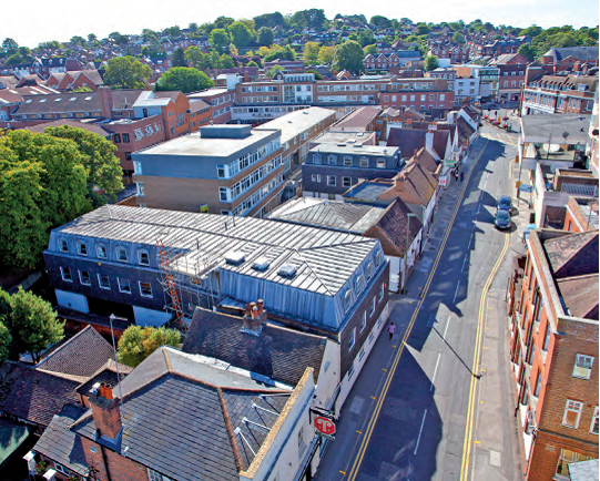 A cluster of four offices buildings in Chertsey St Guildford acquired with THRE.
