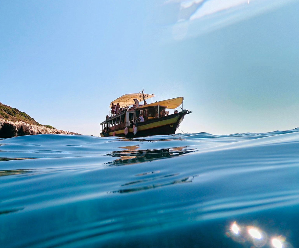 Our red yellow Sandra boat on cape Kamenjak.