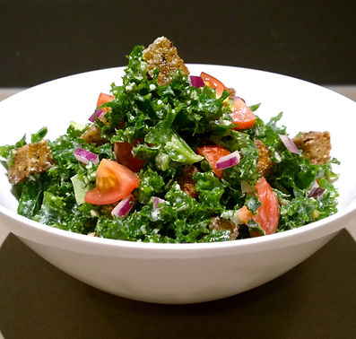 Chopped kale with sweet cherry tomatoes, red onion and homemade wholegrain croutons