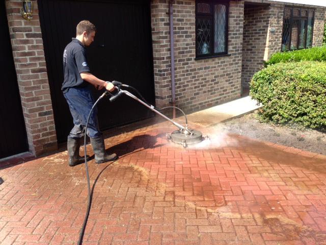 Brick driveway pressure wash