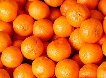 many juicy clementines for sale at veget